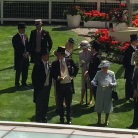 Prince Harry (front left) and the Queen looking at the horses before the race