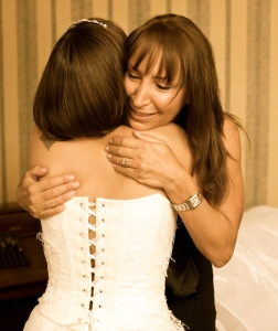My mum and I getting ready on my wedding day.